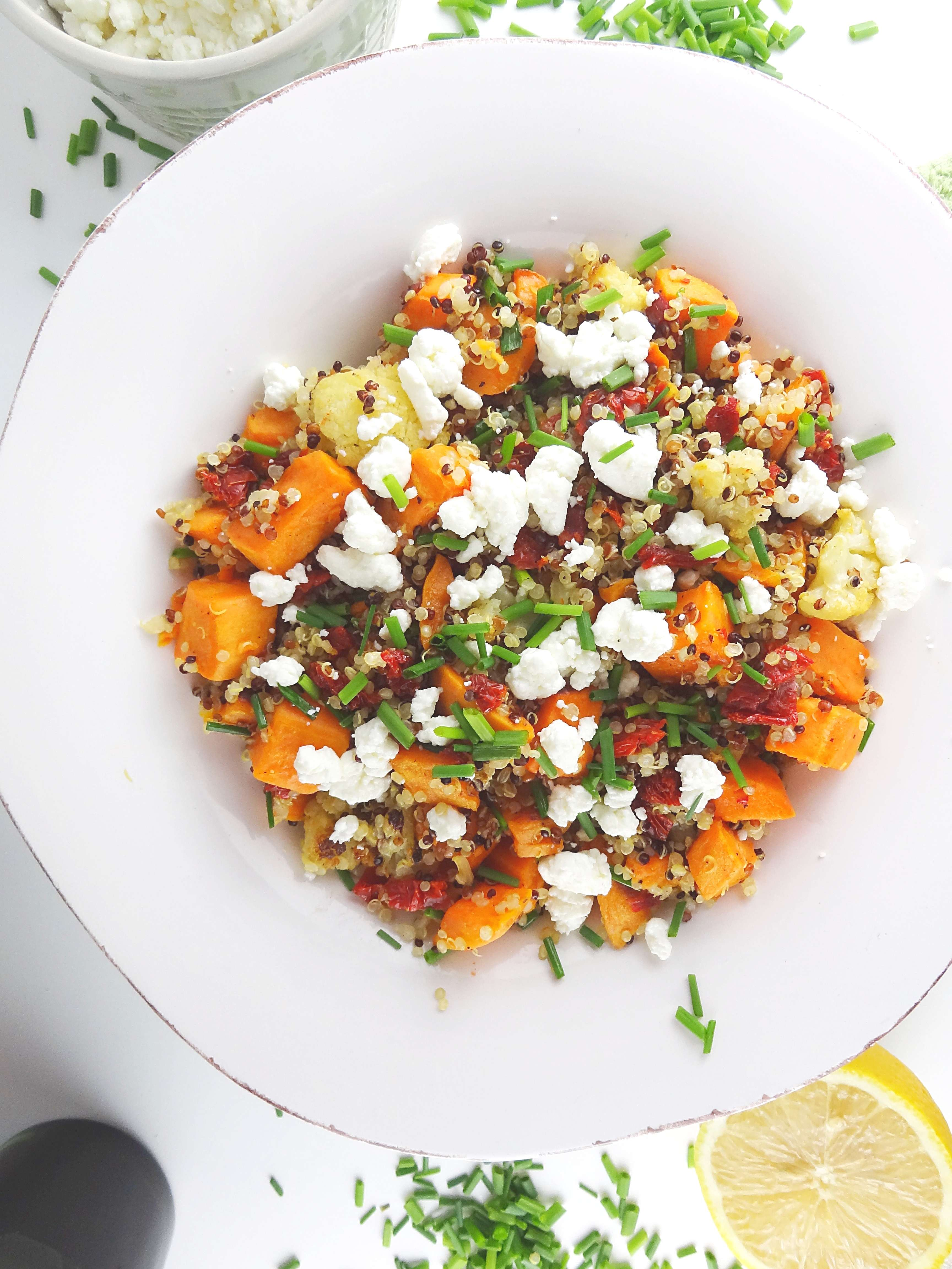 Quinoa Salad with Roasted Sweet Potatoes & Cauliflower from The Cheerful Kitchen. This super healthy side dish recipe is bursting with flavor!