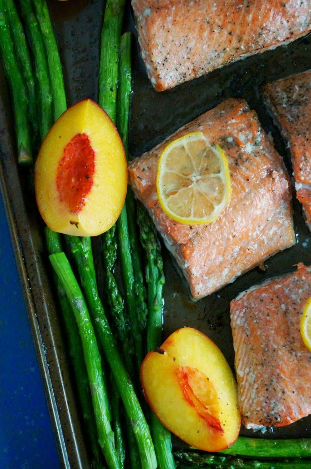 Baked Salmon with Peaches & Asparagus is a low carb, Paleo, gluten-free sheet pan dinner that bakes in about 10 minutes! Thanks to the fresh flavors of lemon and peaches, wild caught salmon and bright green asparagus, this is a dinner that tastes good AND you can feel good about.